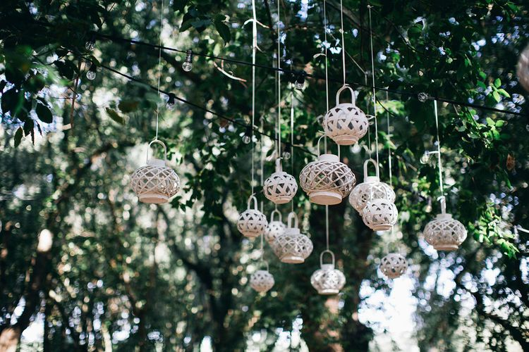 Outdoor Wedding Ceremony Decor | Wicker Lanterns Hanging from Trees | Festoon Lights | Puglian Countryside Wedding with Fairy Light Altar and Olive Grove Aperitivo | Figtree Wedding Photography