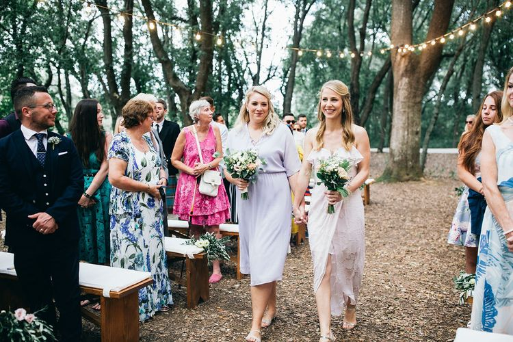 Bridesmaids in Mismatched Lilac Dresses | Bouquets of White, Soft Pink, Purple and Yellow Flowers with Greenery | Festoon Lights | Puglian Countryside Wedding with Fairy Light Altar and Olive Grove Aperitivo | Figtree Wedding Photography