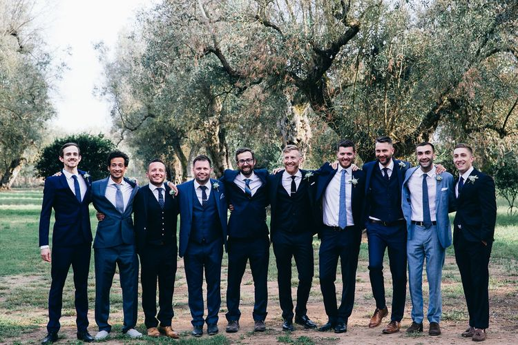Groom in Dark Navy Hugo Boss Suit with Waistcoat and Black Patent Shoes by Common Projects | Groomsmen in Mismatched Navy Suits | Puglian Countryside Wedding with Fairy Light Altar and Olive Grove Aperitivo | Figtree Wedding Photography