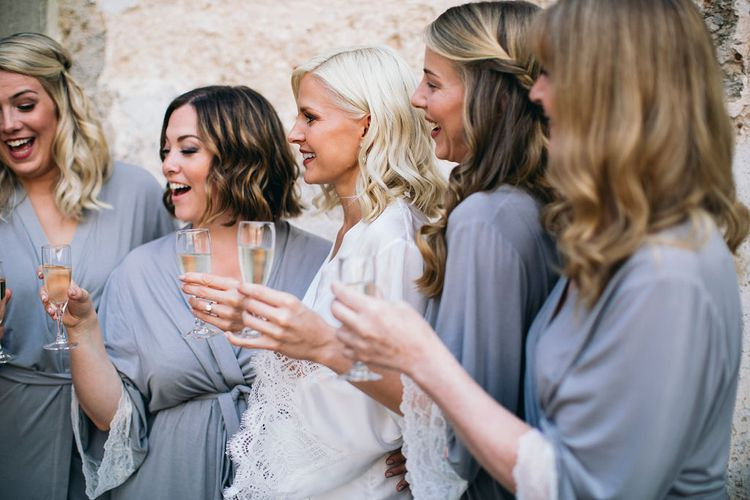 Wedding Morning Preparations at Tenuta Tresca | Bride in White Getting Ready Robe | Bridesmaids in Lilac Getting Ready Robes | Puglian Countryside Wedding with Fairy Light Altar and Olive Grove Aperitivo | Figtree Wedding Photography
