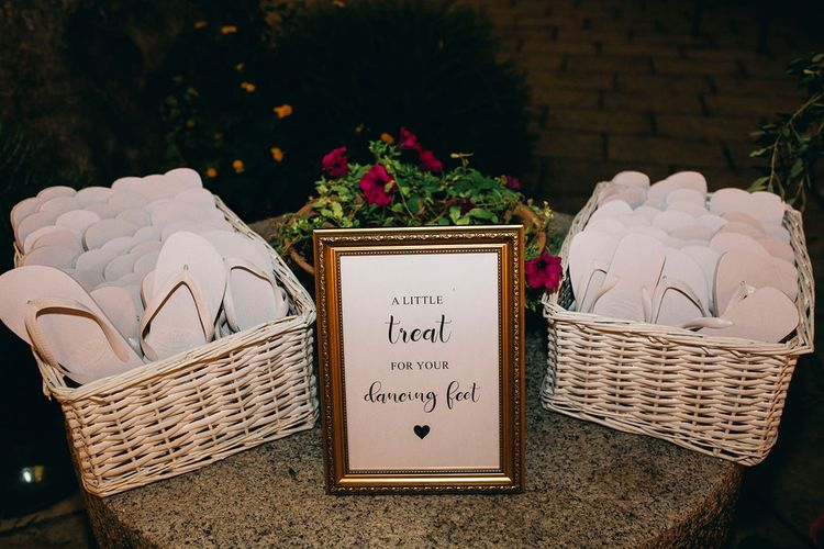 White Flip Flops in Baskets | Puglian Countryside Wedding with Fairy Light Altar and Olive Grove Aperitivo | Figtree Wedding Photography