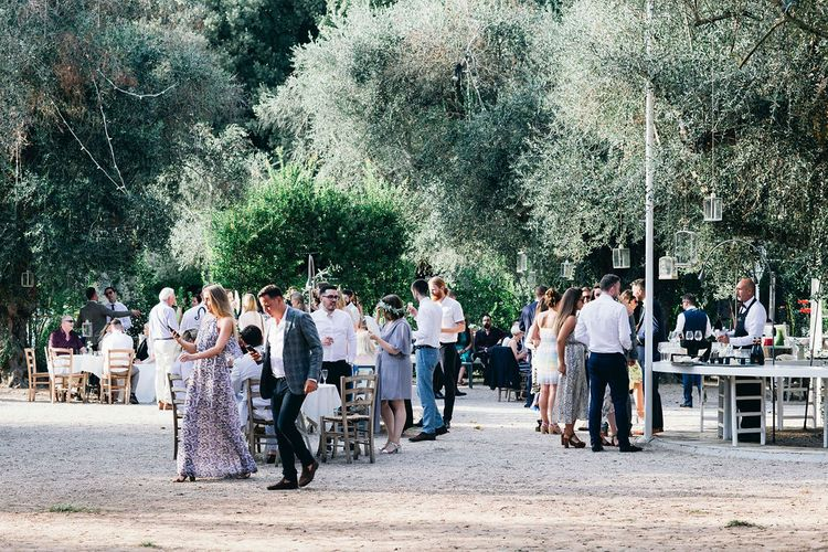 Aperitivo Hour in the Olive Grove at Tenuta Tresca | Puglian Countryside Wedding with Fairy Light Altar and Olive Grove Aperitivo | Figtree Wedding Photography