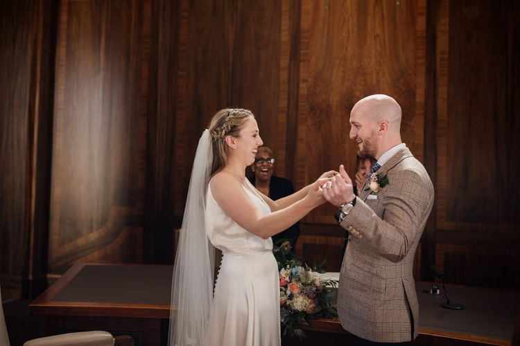 Bride and groom tie the knot at town hall wedding in London