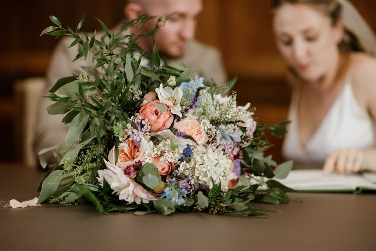 Bride and groom tie the knot at town hall wedding in London with David Austin rose bouquet