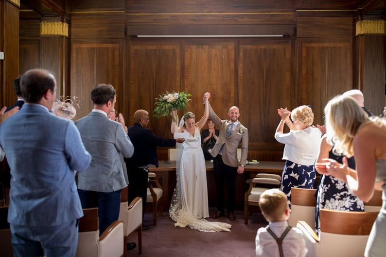 Bride and groom tie the knot at town hall wedding in London with David Austin rose bouquet  and polka dot veil