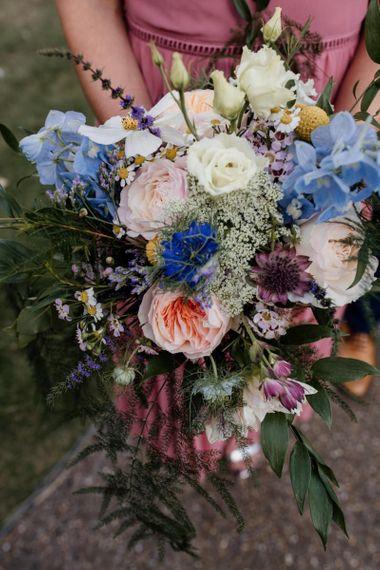 Colourful David Austin rose floral bouquets at West Reservoir Centre wedding