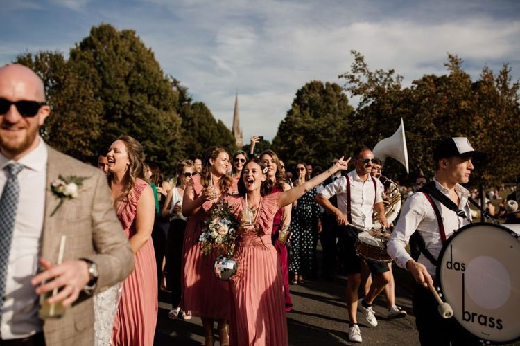 Pink bridesmaid dresses for city wedding with marching band to West Reservoir Centre reception