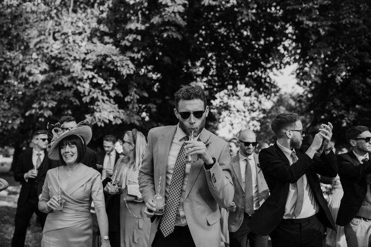 Guest at London wedding with marching band walk to reception