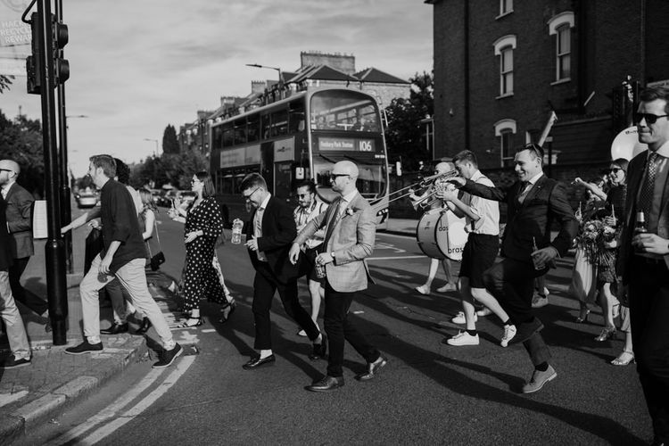 London city wedding with marching band walk to West Reservoir Centre reception