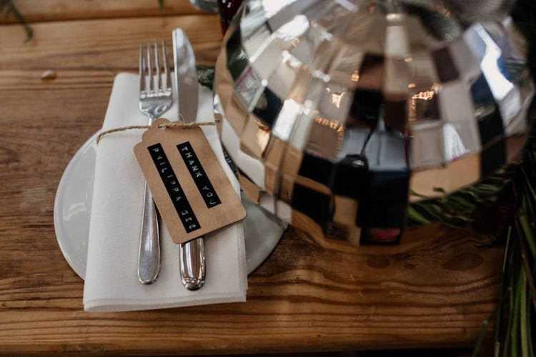 Disco ball table decor and parcel tags for relaxed event in London