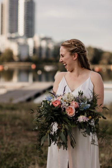 Bride with David Austin rose bouquet of beautiful colours and textures