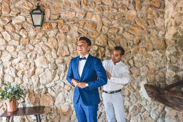 Groom In Blue Suit With Blue Bowtie // Bride In Straw Hat With Leanne Marshall Wedding Dress Destination Wedding In Mallorca With Images From F2 Studios And Film By Alberto & Yago