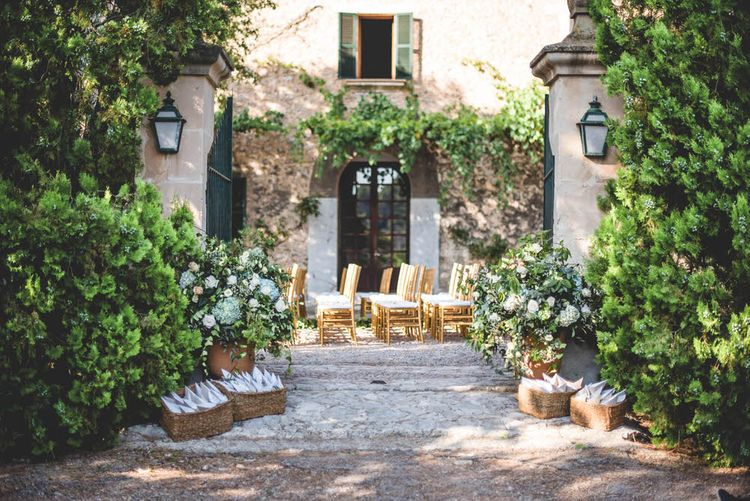 Destination Wedding In Mallorca With Outdoor Ceremony // Bride In Straw Hat With Leanne Marshall Wedding Dress Destination Wedding In Mallorca With Images From F2 Studios And Film By Alberto & Yago