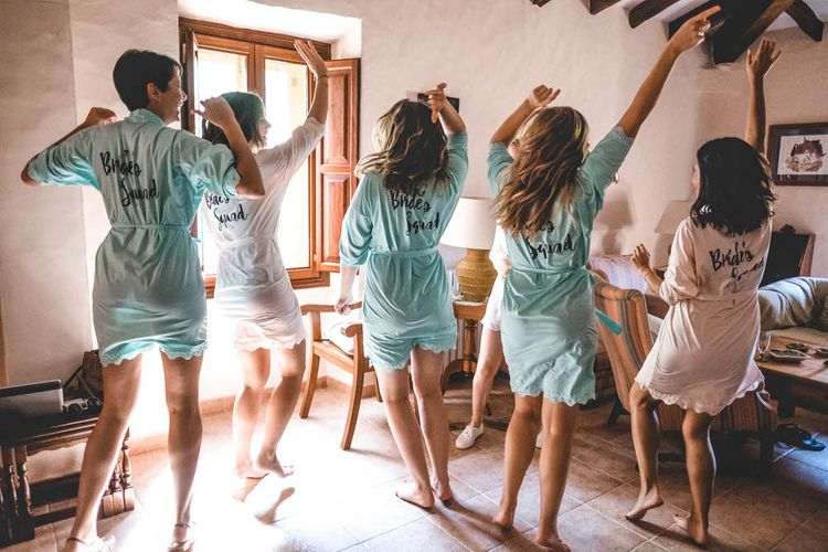 Bride & Bridesmaids In Brides Squad Robes // Bride In Straw Hat With Leanne Marshall Wedding Dress Destination Wedding In Mallorca With Images From F2 Studios And Film By Alberto & Yago