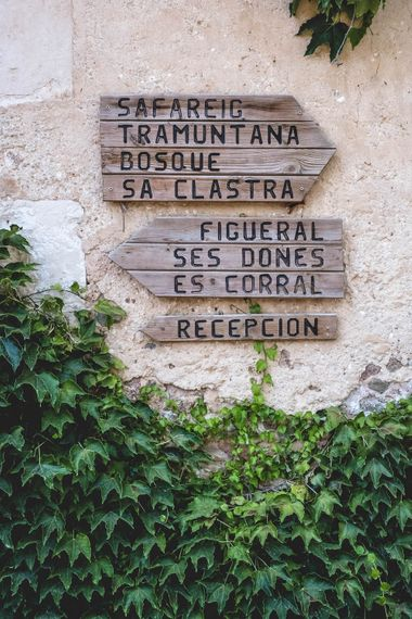 Wooden Signage For Wedding // Bride In Straw Hat With Leanne Marshall Wedding Dress Destination Wedding In Mallorca With Images From F2 Studios And Film By Alberto & Yago