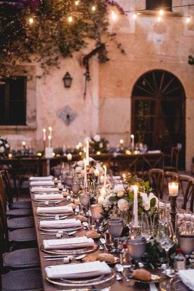 Outdoor Dining With Festoon Lights In Courtyard // Bride In Straw Hat With Leanne Marshall Wedding Dress Destination Wedding In Mallorca With Images From F2 Studios And Film By Alberto & Yago