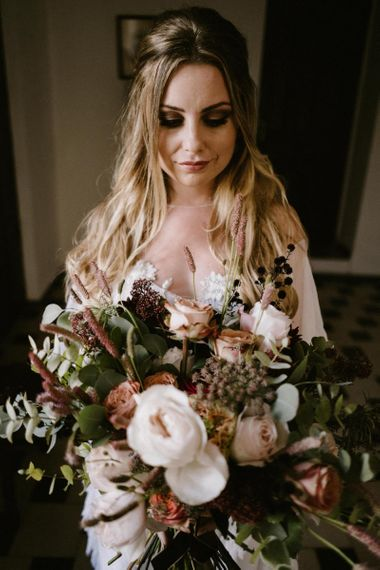 Bride with Half up half Down Hair Holding Her Wedding Bouquet