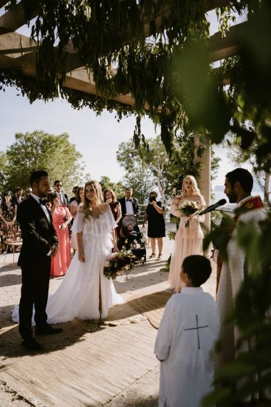 Bride and Groom During Their Outdoor Wedding Ceremony