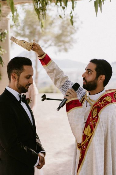 Groom Being Bless with a Crown During The Orthodox Wedding Ceremony