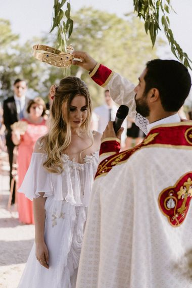 Bride Being Bless with a Crown During The Orthodox Wedding Ceremony