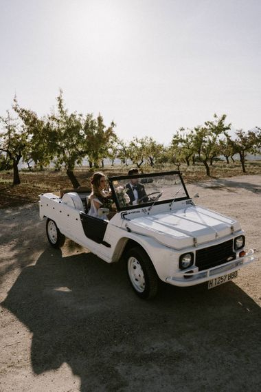 Bride and Groom Travelling in Their Jeep Wedding Car