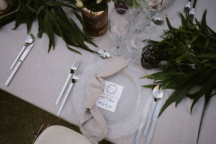 Place Setting with Folded Napkin on Glass Platter and Name Place Card