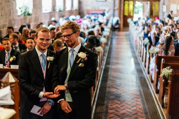 Groom and Best Man at the Altar in Traditional Morning Suits