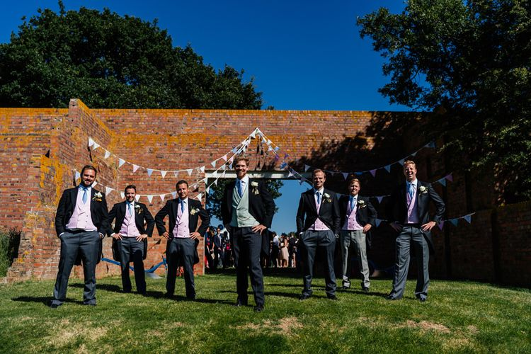 Groomsmen in Traditional Morning Suits with Pastel Coloured Waistcoats