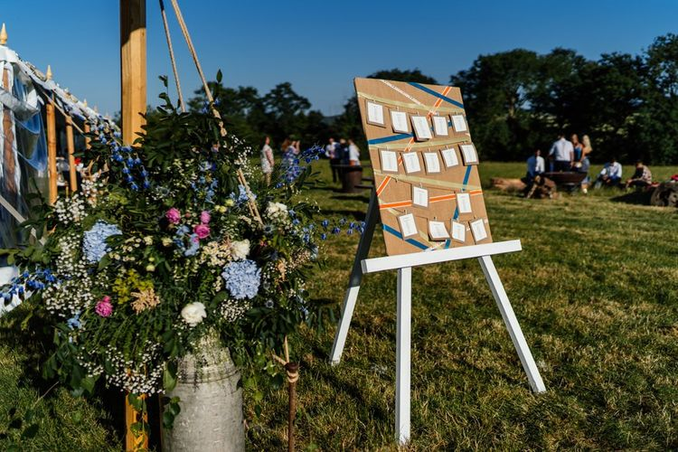 Pastel Wild Flowers in Milk Churn and Table Plan on Easel