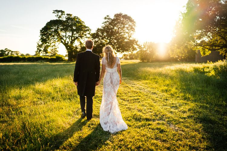 Golden Hour Portrait with Bride in Lace Essense of Australia Wedding Dress and Groom in Morning Suit