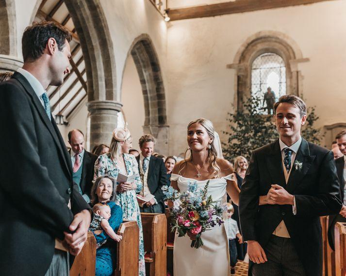 Church wedding ceremony bridal entrance in Halfpenny London wedding dress