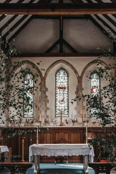Church wedding ceremony altar with plant decor