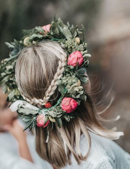 Flower girl with plated hair and peony flower crown