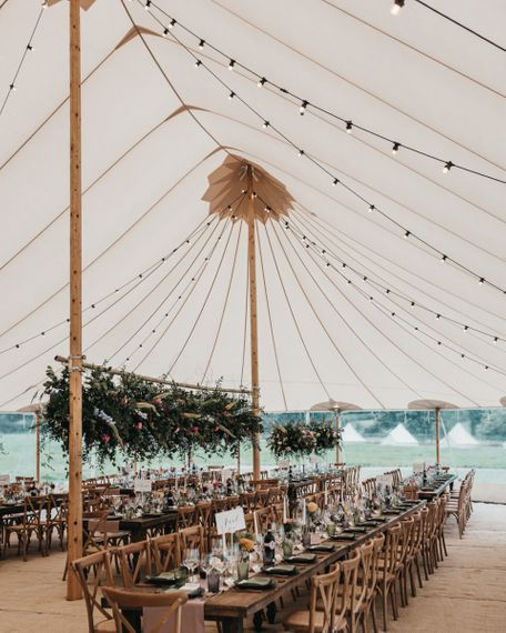 PapaKata Sperry tent reception with festoon lights and flower installation