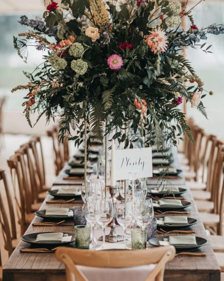 Calligraphy table name signs for Sperry tent reception and church wedding