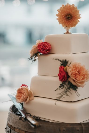 Homemade square royal icing wedding cake with flower decor