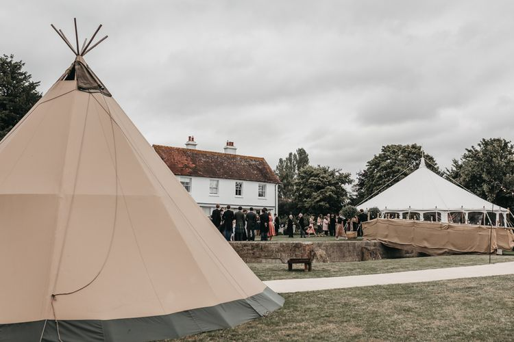 Teepee chill out zone with fire pit for home and church wedding