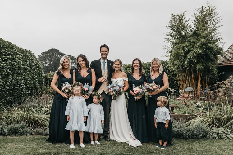 Bridal party portraits with bridesmaids in navy ReWritten dresses