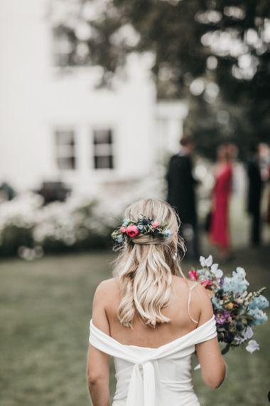 Half up half down wedding hair with fresh flowers for church wedding