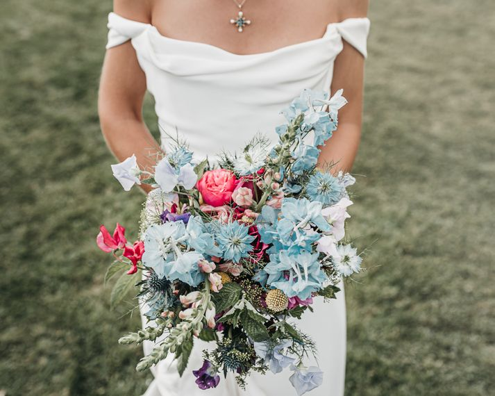 Blue and red wild flower wedding bouquet for church wedding