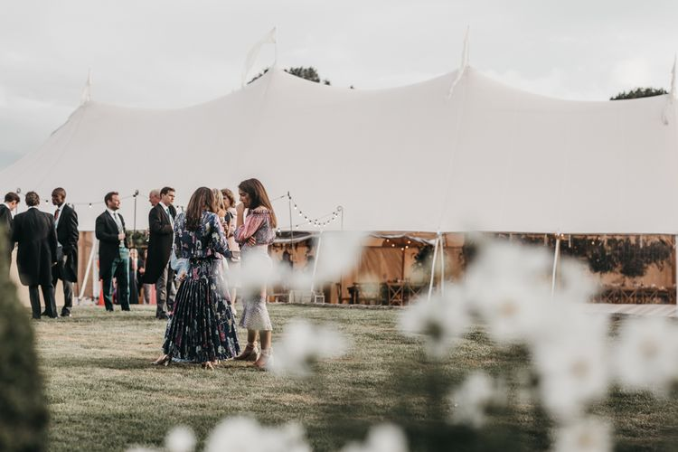 Outdoor Sperry tent reception at Brides family home