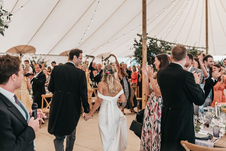 Bride and groom entering their PapaKata Sperry tent reception