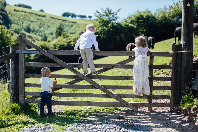 DIY Rustic Wedding in a Sheep Shed | Suzanne Neville Bridal Gown | Donegal Tweed Suits | Bridesmaids inPurple  JLM Couture Special Occasions Dresses | Matt Willis Photography)