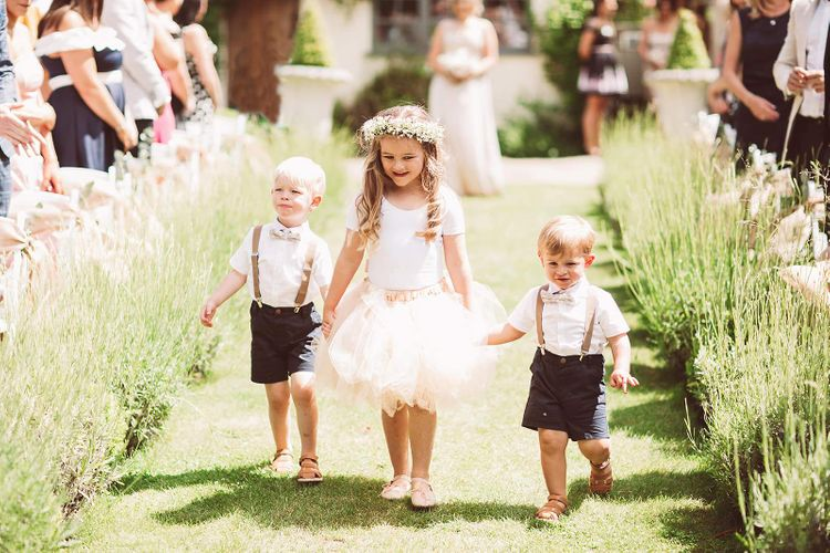 Page Boys and Flower Girl During Wedding Ceremony