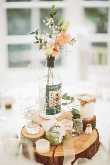 Rustic Centrepiece with Flowerstem in Gin Bottle