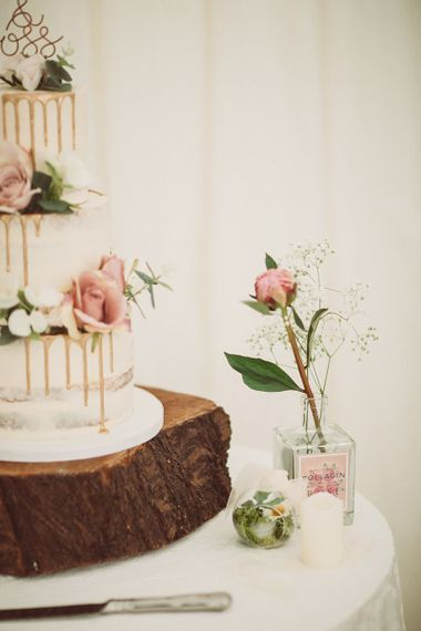 Drip Wedding Cake on Tree Trunk Slice