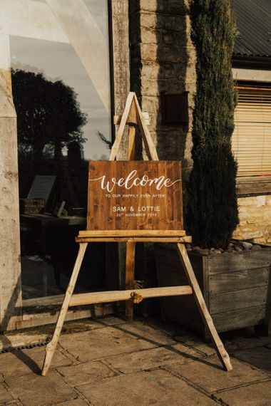 Wooden welcome sign at November wedding