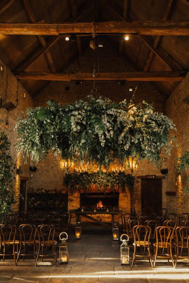 Foliage chandelier and candle light decor for November wedding