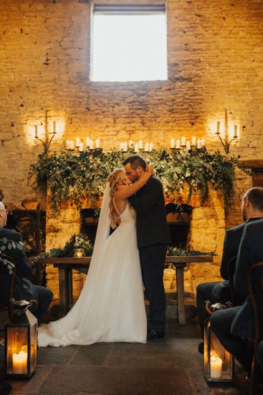 Cripps Barn fireplace wedding decor with foliage and candles