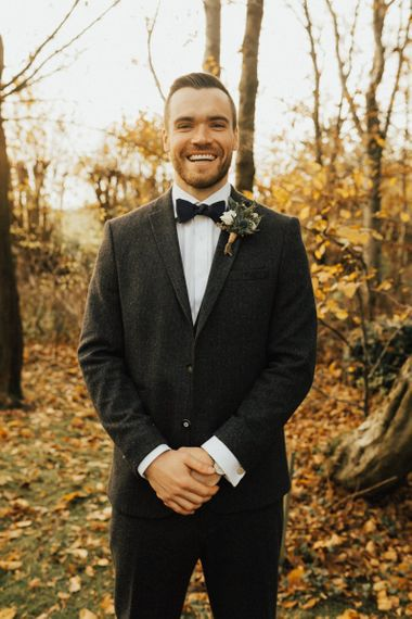 Groom in wool suit and bow tie for November wedding